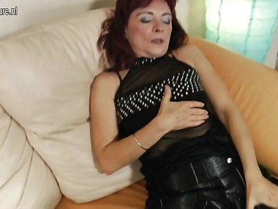 Redhead granny loves to work her hairy pussy