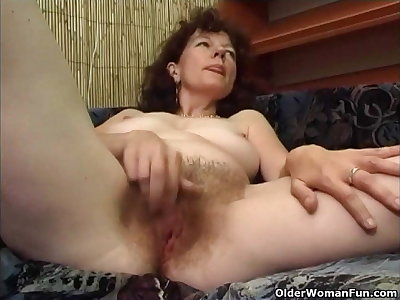 Hairy granny masturbates with a dildo