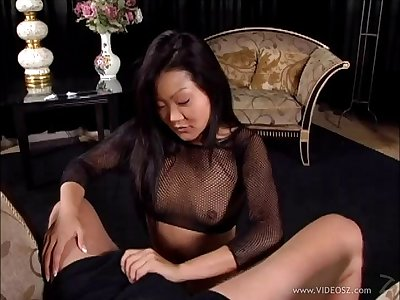 Enticing Asian cougar in fishnet stockings reward her suppliant a superb handjob in a reality shoot