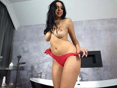 Kira Queen titty fucks and sucks in an upscale go to the powder-room