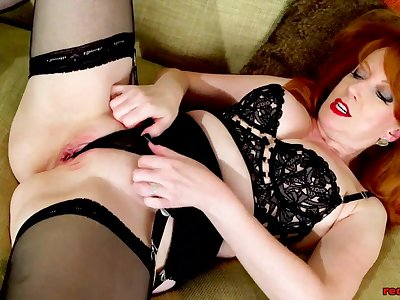Big knocker redhead mature Red XXX toys her creamy pussy