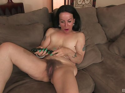 Mature slut Nina Swiss spreads will not hear of legs to simian will not hear of old cunt
