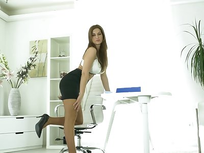 Busty secretary Carol Gold spreads her toes to masturbate in the office