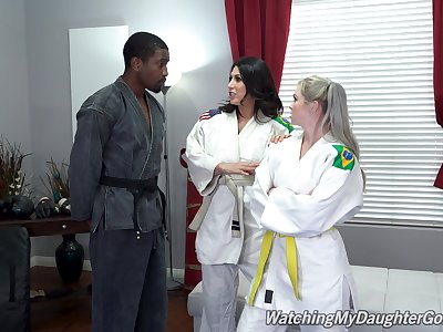 Fine women share a huge insidious dick in Karate XXX threesome
