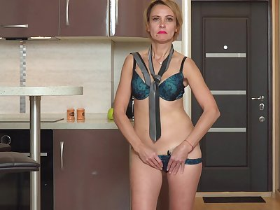 Sexy blondie Oliya drops her panties to take a crack at fun in the kitchen