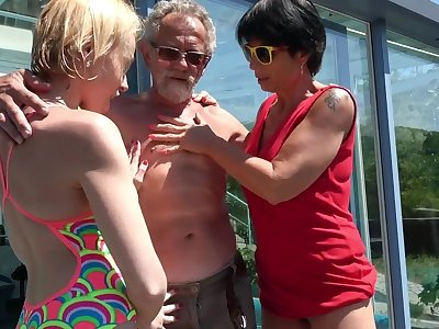 Outdoors FFM threesome between an older team of two added to younger Darina